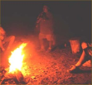 Native Americans around a campfire.