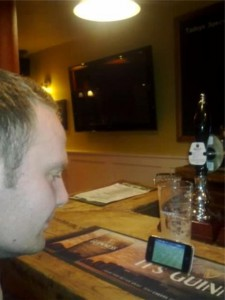 Glenn (not Glyn !) watching football on an Iphone.