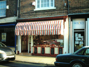 The very helpfull Butcher on Northgate Street, C S Austin