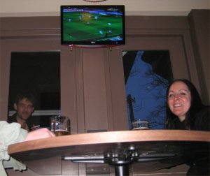 Sports bar. Who's the sinister figure lurking outside ?