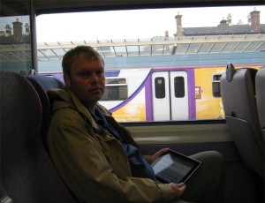 Using the Ipad on the train to work.