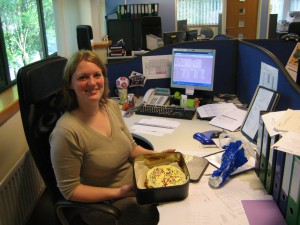 Lyndsay with the cake that she made.