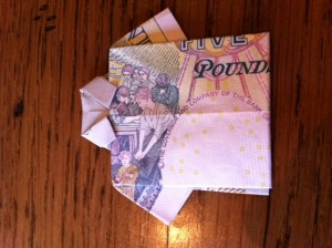 Miniature Origami shirt made from a £5 note.