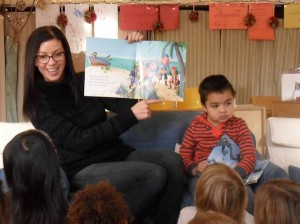 Back home in the US, Jess reading a book to the school children