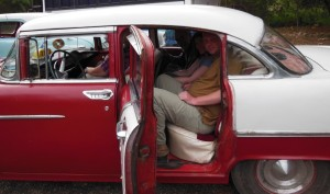 Me in an old American car in Cuba