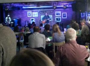 Noel singing at Alexanders.