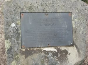 Steel plaque fastened to a rock.