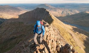 Climber walking the Crib Goch ridge.