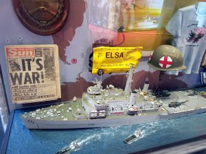 "Some memorabilia from the Falklands conflict including the front page of the Sun newspaper ""It's War!"""