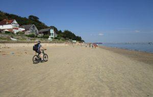 Mountain bike riding across the beach