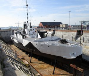 A grey and black metal warship from the 1st world war