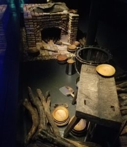 A brick oven and some old cooking equipment