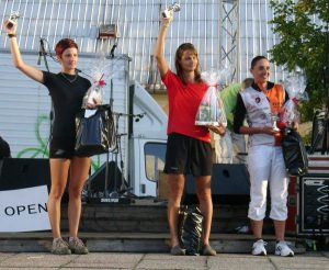 My friend Monika holding up a trophy.