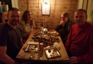Oliver, Jess, Dale and I sat at a table having dinner at Mogli in Liverpool.