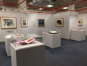 Inside an art gallery showing a display of Pop art.