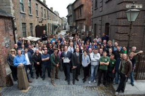 The entire cast of Ripper Street, standing in an old fashioned street in Ireland.