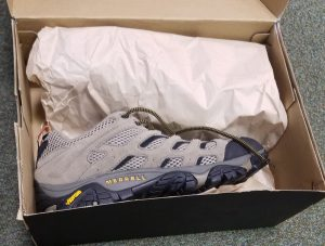 Some brand new Merrell trainers in a box just opened.