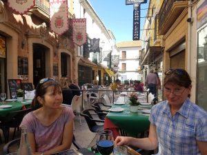 Having lunch outside in a busy street