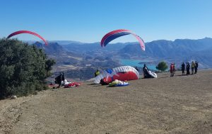 Paragliders launching from high in the mountains