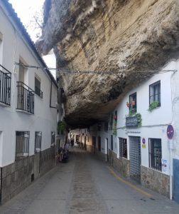 """Some houses on each side with a rock """"roof"""""""