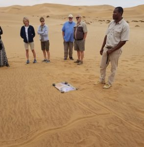 Our guide with a map of Namibia drawn in the sand
