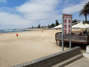 Swakopmund beach with a confusing sign